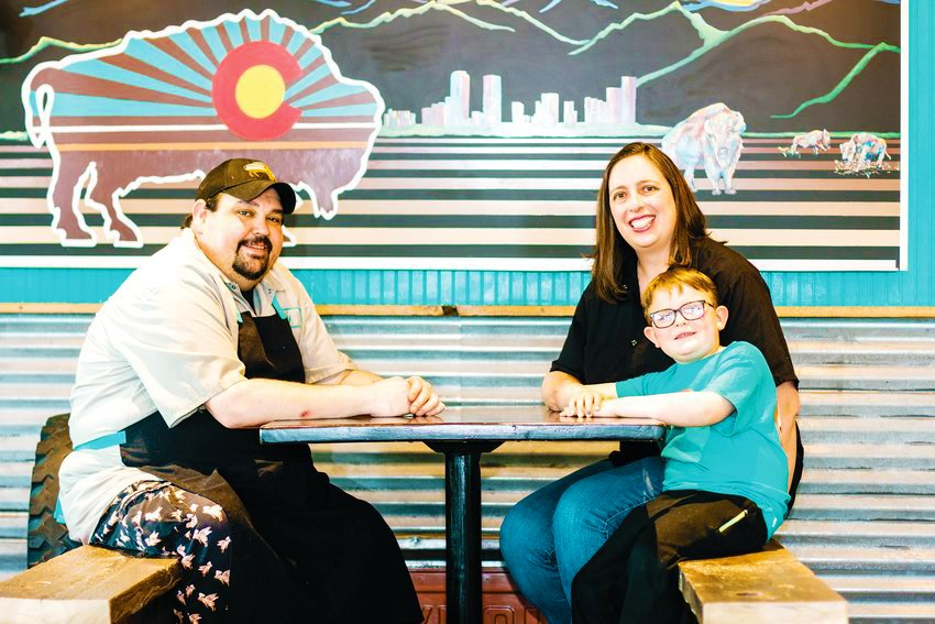 Roaming Buffalo BBQ's Coy, Rachael and Carter Webb sit for a portrait.
